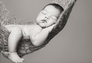 newborn in hammock